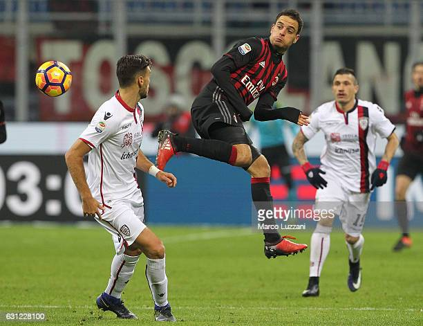 Giacomo Bonaventura of AC Milan is challenged by Luca Ceppitelli of Cagliari Calcio during the Serie A match between AC Milan and Cagliari Calcio at...