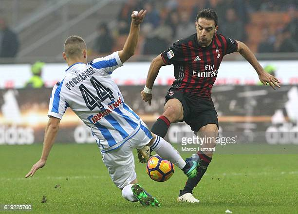 Giacomo Bonaventura of AC Milan is challenged by Michele Fornasier of Pescara Calcio during the Serie A match between AC Milan and Pescara Calcio at...