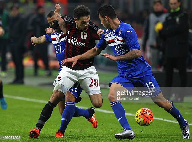 Giacomo Bonaventura of AC Milan is challenged by Pedro Miguel Pereira and Angelo Palombo of UC Sampdoria during the Serie A match between AC Milan...