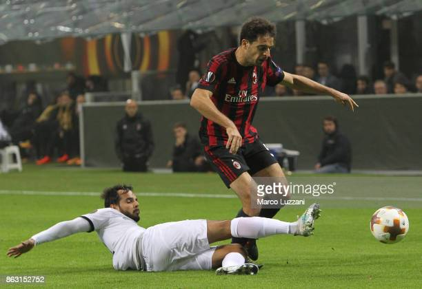 Giacomo Bonaventura of AC Milan is challenged by Rodrigo Galo of AEK Athens during the UEFA Europa League group D match between AC Milan and AEK...