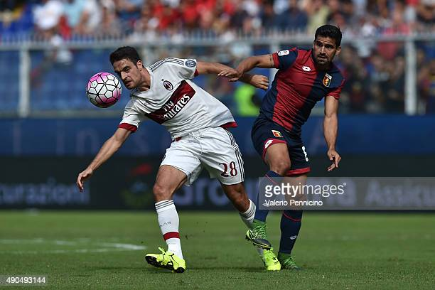 Giacomo Bonaventura of AC Milan is challenged by Tomas Rincon of Genoa CFC during the Serie A match between Genoa CFC and AC Milan at Stadio Luigi...