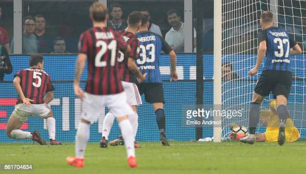 Giacomo Bonaventura of AC Milan scores his goal during the Serie A match between FC Internazionale and AC Milan at Stadio Giuseppe Meazza on October...