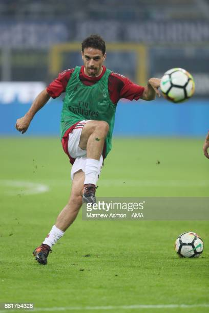 Giacomo Bonaventura of AC Milan warms up prior to the Serie A match between FC Internazionale and AC Milan at Stadio Giuseppe Meazza on October 15...