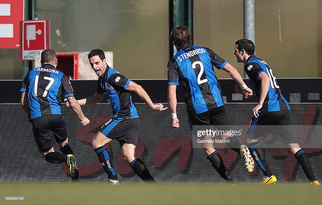 Giacomo Bonaventura (2nd to L) of Atalanta Bc celebrates after scoring a goal during the Serie A match between AC Siena and Atalanta BC at Stadio Artemio Franchi on March 3, 2013 in Siena, Italy.
