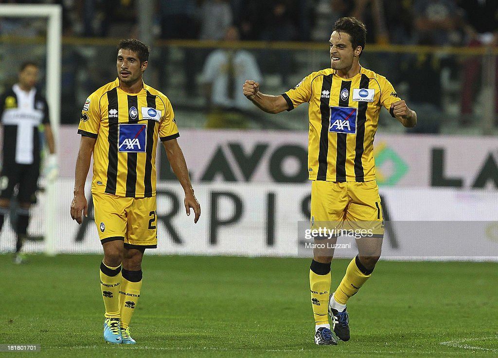 <a gi-track='captionPersonalityLinkClicked' href=/galleries/search?phrase=Giacomo+Bonaventura&family=editorial&specificpeople=5442052 ng-click='$event.stopPropagation()'>Giacomo Bonaventura</a> of Atalanta BC (R) celebrates after scoring a goal during the Serie A match between Parma FC and Atalanta BC at Stadio Ennio Tardini on September 25, 2013 in Parma, Italy.