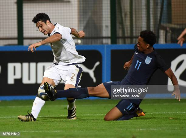 Giacomo Caccin of Italy U20 competes for the ball with Chris Willock of England U20 during the 8 Nations Tournament match between Italy U20 and...