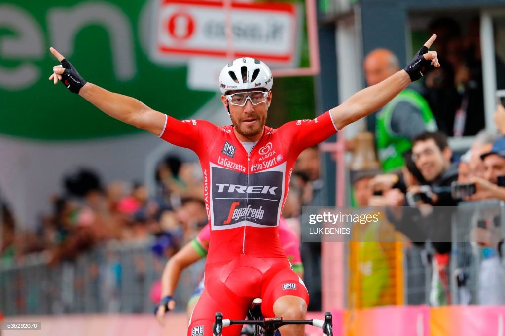 Giacomo Nizzolo of the Trek team celebrates as he crosses the finish line to win the 21th and last stage of the 99th Giro d'Italia, Tour of Italy, from Cuneo to Turin on May 29, 2016. Astana's Vincenzo Nibali secured his second Giro d'Italia triumph today after topping a dramatic 99th edition that saw key rival Steven Kruijswijk crash in the final stages of the race. Giacomo Nizzolo, of the Trek team, claimed the final stage honours after outsprinting his rivals in a bunch sprint in Turin. Nibali, who won the race for the first time in 2013, becomes the 69th Italian in 99 editions to win the race for the pink jersey. / AFP / Luk BENIES