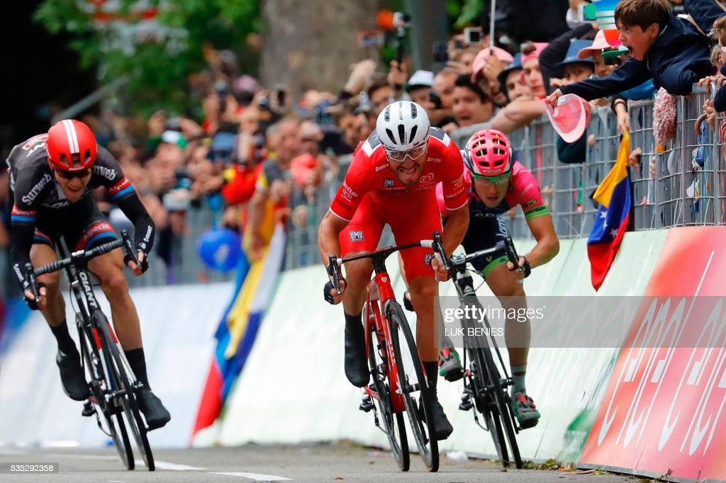 Giacomo Nizzolo (C) of the Trek team, Germany's Nikias Arndt (L) of team Giant and Sacha Modolo (R) of Lampre sprint to cross the finish line of the 21th and last stage of the 99th Giro d'Italia, Tour of Italy, from Cuneo to Turin on May 29, 2016. Giacomo Nizzolo of the Trek team was stripped of victory in the final stage of the Giro d'Italia today after deviating from his sprint line. Nizzolo thought he had claimed his maiden win from the race and even carried out post-stage interviews. But the Italian fell back to earth with a bump after race judges ruled that he broke rules by deviating from his line, a move which stopped other riders -- including Sacha Modolo of Lampre -- from challenging for the stage victory. It meant the stage victory goes to Germany's Nikias Arndt, of Giant. PHOTO / Luk BENIES / The erroneous mention[s] appearing in the metadata of this photo by Luk BENIES has been modified in AFP systems in the following manner: [---] instead of [---]. Please immediately remove the erroneous mention[s] from all your online services and delete it (them) from your servers. If you have been authorized by AFP to distribute it (them) to third parties, please ensure that the same actions are carried out by them. Failure to promptly comply with these instructions will entail liability on your part for any continued or post notification usage. Therefore we thank you very much for all your attention and prompt action. We are sorry for the inconvenience this notification may cause and remain at your disposal for any further information you may require.