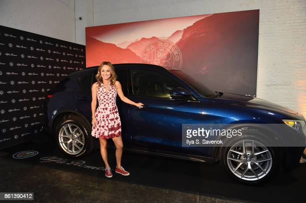 Giada De Laurentiis poses with an Alpha Romeo the Food Network Cooking Channel New York City Wine Food Festival Presented By CocaCola Alfa Romeo...