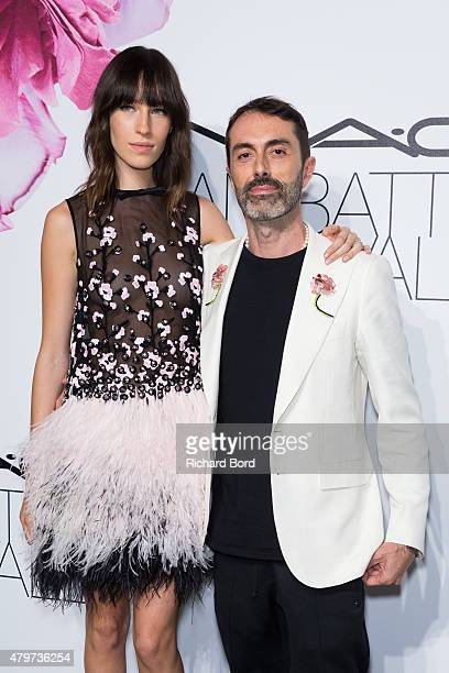 Giambattista Valli and a guest attend the MAC Cosmetics Giambattista Valli Floral Obsession Ball at Opera Garnier on July 6 2015 in Paris France