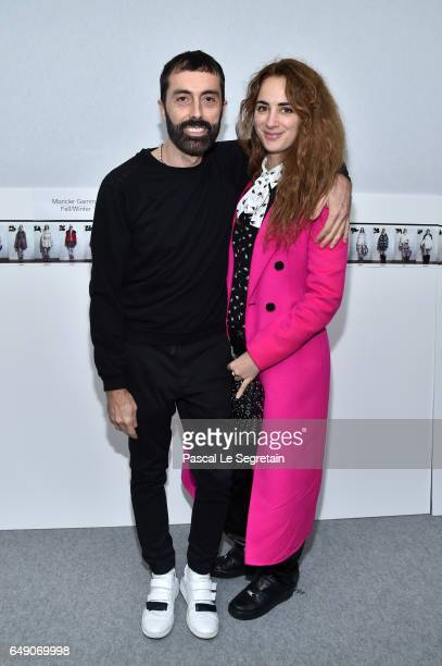 Giambattista Valli and Alexia Niedzelski attend the Moncler Gamme Rouge show as part of the Paris Fashion Week Womenswear Fall/Winter 2017/2018 on...