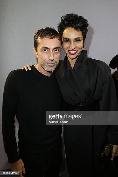 Giambattista Valli and Farida Khelfa pose together backstage at the Giambattista Valli Fall/Winter 2013 ReadytoWear show as part of Paris Fashion...