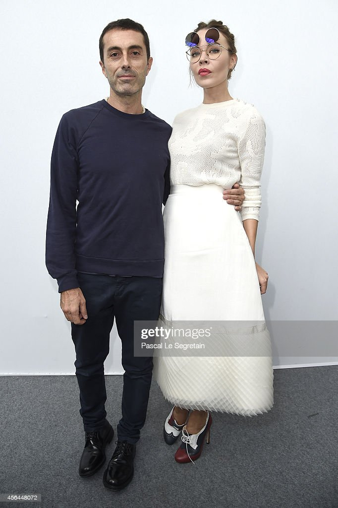 Giambattista Valli and Ulyana Sergeenko pose backstage after the Moncler Gamme Rouge show as part of the Paris Fashion Week Womenswear Spring/Summer...