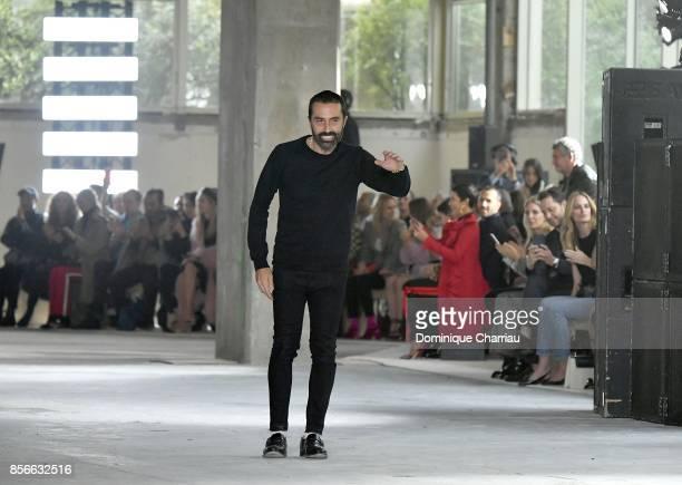 Giambattista Valli walks after the runway following the Giambattista Valli show as part of the Paris Fashion Week Womenswear Spring/Summer 2018 on...