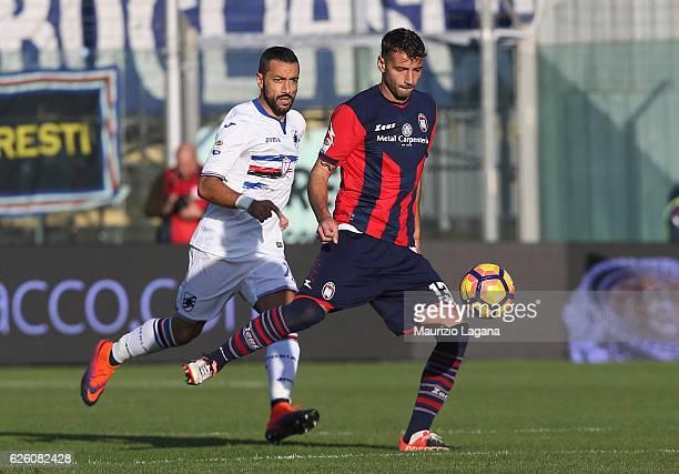 Giammarco Ferrari of Crotone competes for the ball with Fabio Quagliarella of Sampdoria during the Serie A match between FC Crotone and UC Sampdoria...