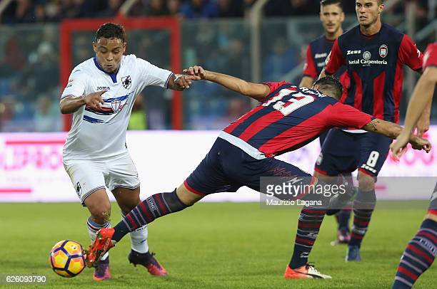 Giammarco Ferrari of Crotone competes for the ball with Luis Muriel of Sampdoria during the Serie A match between FC Crotone and UC Sampdoria at...