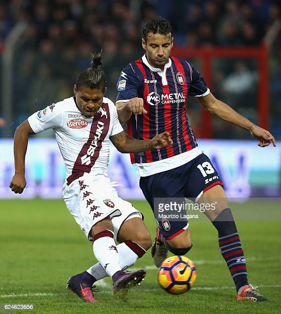 Giammaro Ferrari of Crotone competes for the ball with Josef Martinez of Torino during the Serie A match between FC Crotone and FC Torino at Stadio...