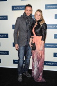 Giampaolo Pazzini and Silvia Pazzini attend Marcolin Hosts 'Sguardi d'Atelier' Exhibition on March 5 2013 in Milan Italy