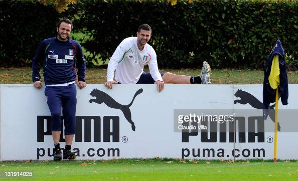 Giampaolo Pazzini and Thiago Motta of Italy smile during a training session at Coverciano on November 8 2011 in Florence Italy