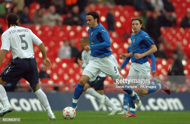 Giampaolo Pazzini bursts through England's defence to score the first goal of the game
