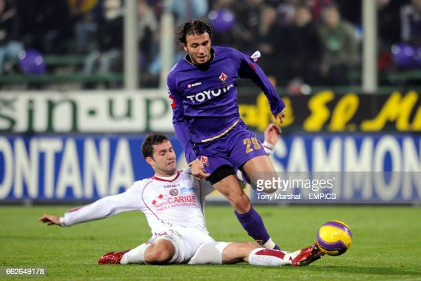 Giampaolo Pazzini Fiorentina and Dario Knezevic Livorno battle for the ball