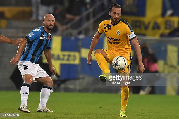 Giampaolo Pazzini od Hellas Verona controls the ball as Andrea Lisuzzo of Pisa tackles during the Serie B match between AC Pisa and Hells Verona at...