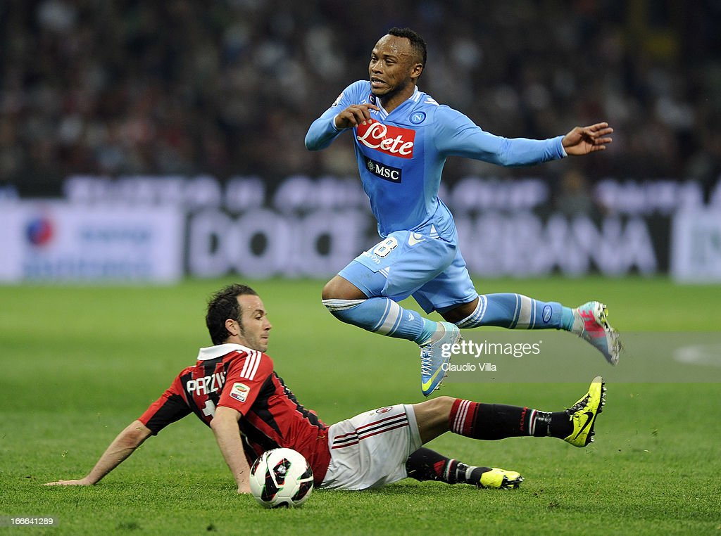 Giampaolo Pazzini of AC Milan and Juan Zuniga of SSC Napoli (R) compete for the ball during the Serie A match between AC Milan and SSC Napoli at San Siro Stadium on April 14, 2013 in Milan, Italy.