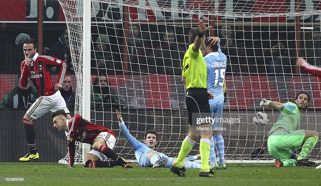 <a gi-track='captionPersonalityLinkClicked' href=/galleries/search?phrase=Giampaolo+Pazzini&family=editorial&specificpeople=800179 ng-click='$event.stopPropagation()'>Giampaolo Pazzini</a> (L) of AC Milan celebrates after scoring the opening goal during the Serie A match between AC Milan and S.S. Lazio at San Siro Stadium on March 2, 2013 in Milan, Italy.