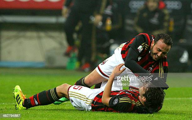Giampaolo Pazzini of AC Milan celebrates after scoring with his teammate Andrea Poli during the TIM Cup match between AC Milan and AC Spezia at...
