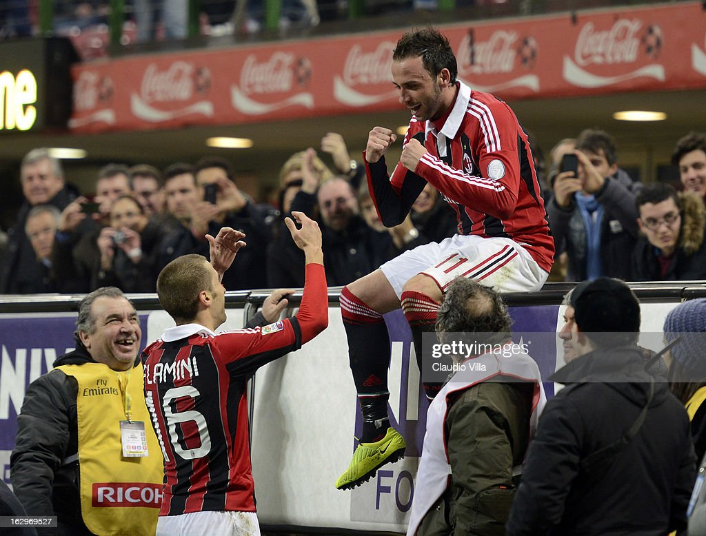 <a gi-track='captionPersonalityLinkClicked' href=/galleries/search?phrase=Giampaolo+Pazzini&family=editorial&specificpeople=800179 ng-click='$event.stopPropagation()'>Giampaolo Pazzini</a> of AC Milan (R) celebrates scoring the first goal during the Serie A match between AC Milan and S.S. Lazio at San Siro Stadium on March 2, 2013 in Milan, Italy.