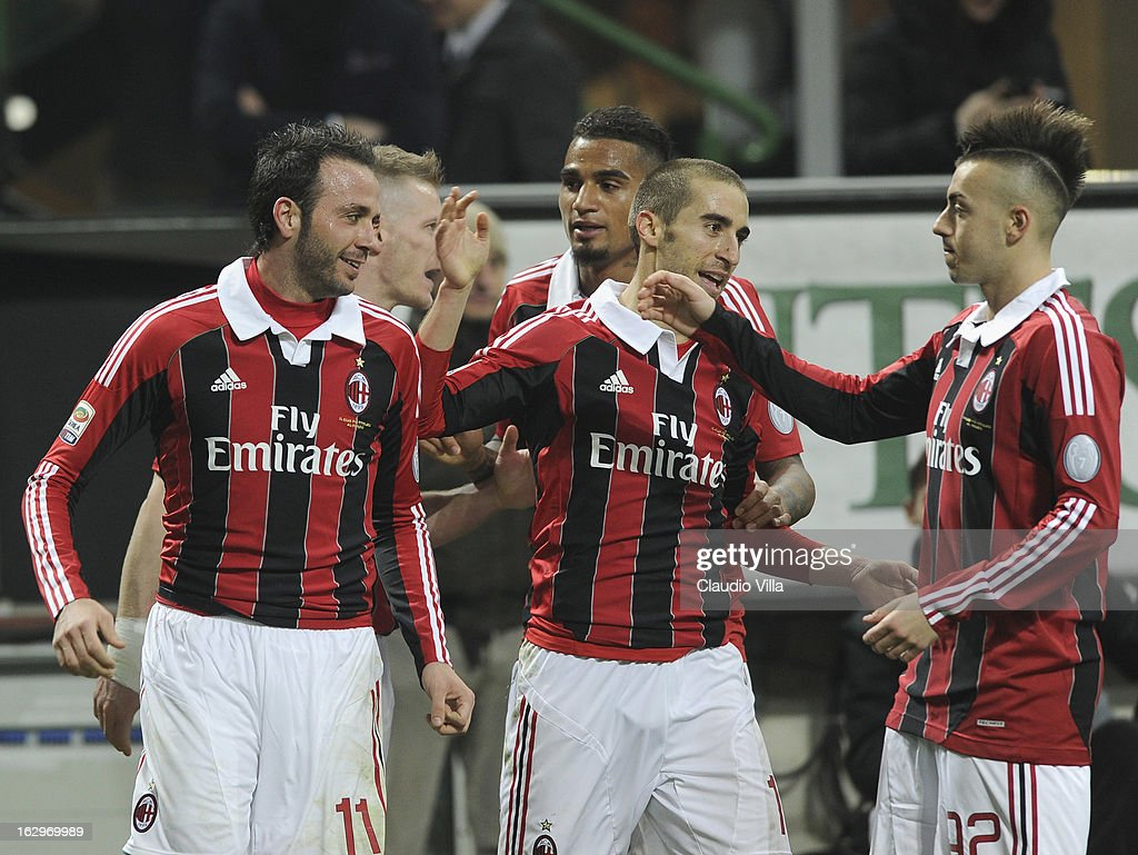 Giampaolo Pazzini of AC Milan (L) celebrates scoring the third goal during the Serie A match between AC Milan and S.S. Lazio at San Siro Stadium on March 2, 2013 in Milan, Italy.