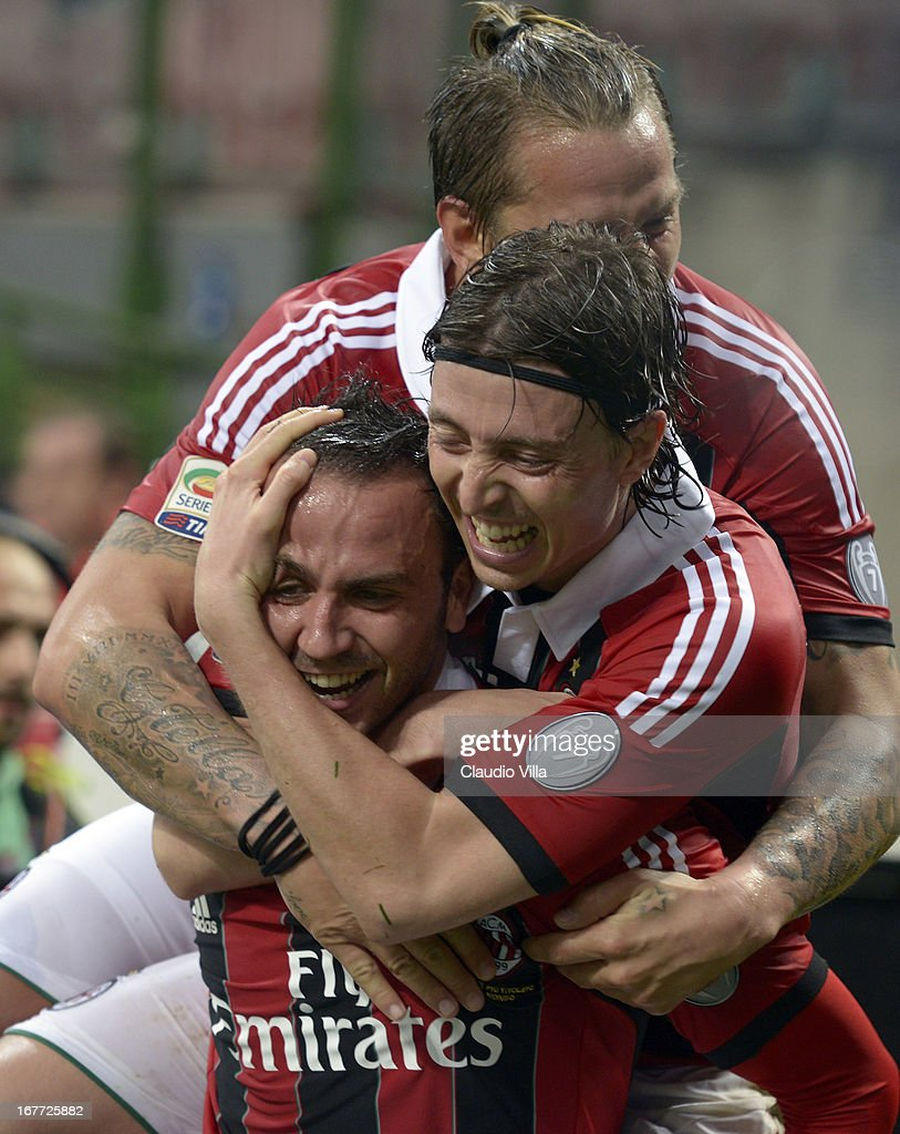 <a gi-track='captionPersonalityLinkClicked' href=/galleries/search?phrase=Giampaolo+Pazzini&family=editorial&specificpeople=800179 ng-click='$event.stopPropagation()'>Giampaolo Pazzini</a> of AC Milan celebrates scoring the third goal with team-mate <a gi-track='captionPersonalityLinkClicked' href=/galleries/search?phrase=Riccardo+Montolivo&family=editorial&specificpeople=605846 ng-click='$event.stopPropagation()'>Riccardo Montolivo</a> (R) during the Serie A match between AC Milan and Calcio Catania at San Siro Stadium on April 28, 2013 in Milan, Italy.