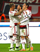 Giampaolo Pazzini of AC Milan celebrates with his team mates Philippe Mexes and Riccardo Saponara after scoring the opening goal during Luigi...