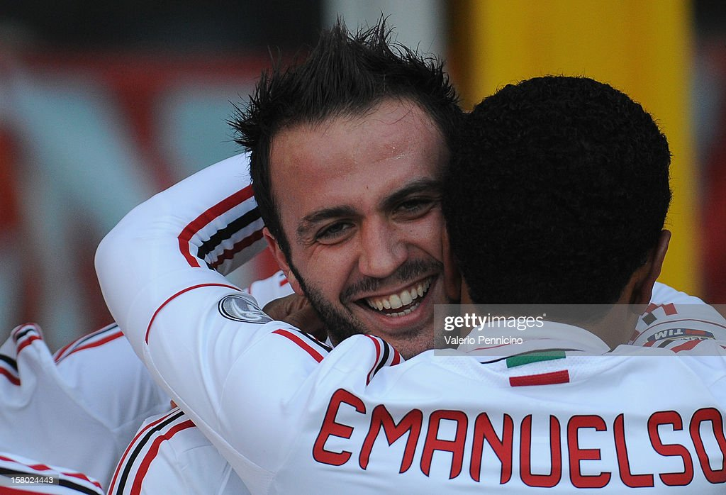 Giampaolo Pazzini (L) of AC Milan celebrates with his team-mates after scoring their third goal during the Serie A match between Torino FC and AC Milan at Stadio Olimpico di Torino on December 9, 2012 in Turin, Italy.