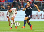 Giampaolo Pazzini of AC Milan chases the ball against Kostas Manolas of Olympiacos FC during International Champions Cup 2014 action at BMO Field...