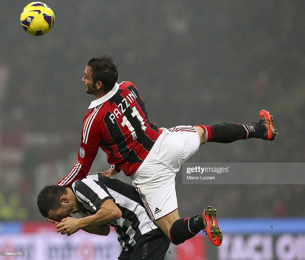 <a gi-track='captionPersonalityLinkClicked' href=/galleries/search?phrase=Giampaolo+Pazzini&family=editorial&specificpeople=800179 ng-click='$event.stopPropagation()'>Giampaolo Pazzini</a> of AC Milan competes for the ball with <a gi-track='captionPersonalityLinkClicked' href=/galleries/search?phrase=Leonardo+Bonucci&family=editorial&specificpeople=6166090 ng-click='$event.stopPropagation()'>Leonardo Bonucci</a> of Juventus FC during the Serie A match between AC Milan and Juventus FC at San Siro Stadium on November 25, 2012 in Milan, Italy.