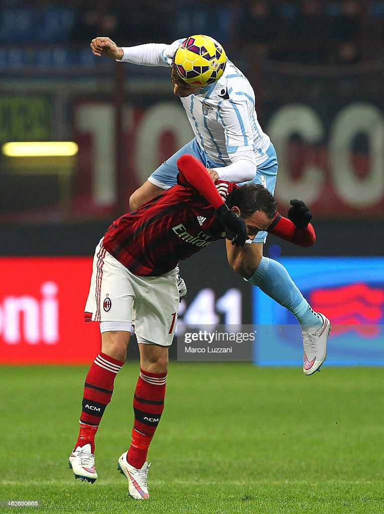 Giampaolo Pazzini (down) of AC Milan competes for the ball with Lorik Cana (up) of SS Lazio during the TIM Cup match between AC Milan and SS Lazio at Stadio Giuseppe Meazza on January 27, 2015 in Milan, Italy.