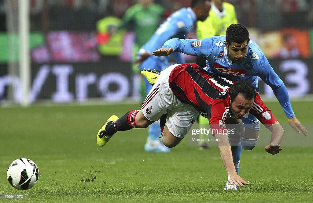 <a gi-track='captionPersonalityLinkClicked' href=/galleries/search?phrase=Giampaolo+Pazzini&family=editorial&specificpeople=800179 ng-click='$event.stopPropagation()'>Giampaolo Pazzini</a> of AC Milan competes for the ball with Miguel Angel Britos of SSC Napoli during the Serie A match between AC Milan and SSC Napoli at San Siro Stadium on April 14, 2013 in Milan, Italy.