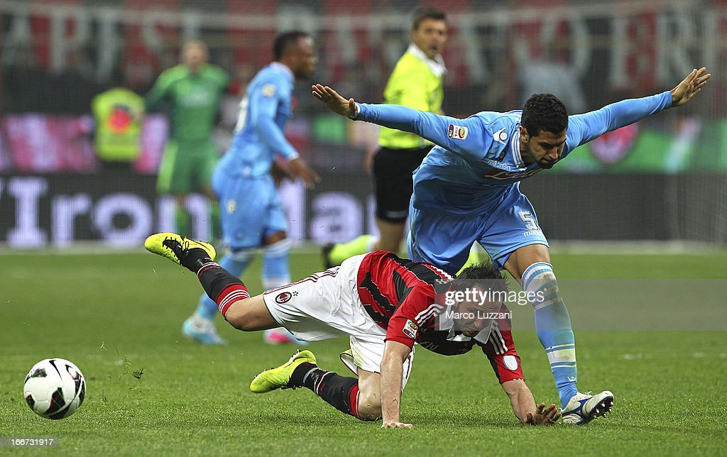 Giampaolo Pazzini of AC Milan competes for the ball with Miguel Angel Britos of SSC Napoli during the Serie A match between AC Milan and SSC Napoli at San Siro Stadium on April 14, 2013 in Milan, Italy.