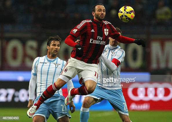 Giampaolo Pazzini of AC Milan competes for the ball with Stefan Radu and Lorik Cana of SS Lazio during the TIM Cup match between AC Milan and SS...