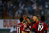Giampaolo Pazzini of AC Milan is congratulated by Phillippe Mexes of AC Milan after scoring his teams fourth goal during the Dubai Football Challenge...