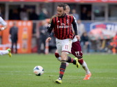 Giampaolo Pazzini of AC Milan scores the third goal during the Serie A match between AC Milan and AS Livorno Calcio at San Siro Stadium on April 19...