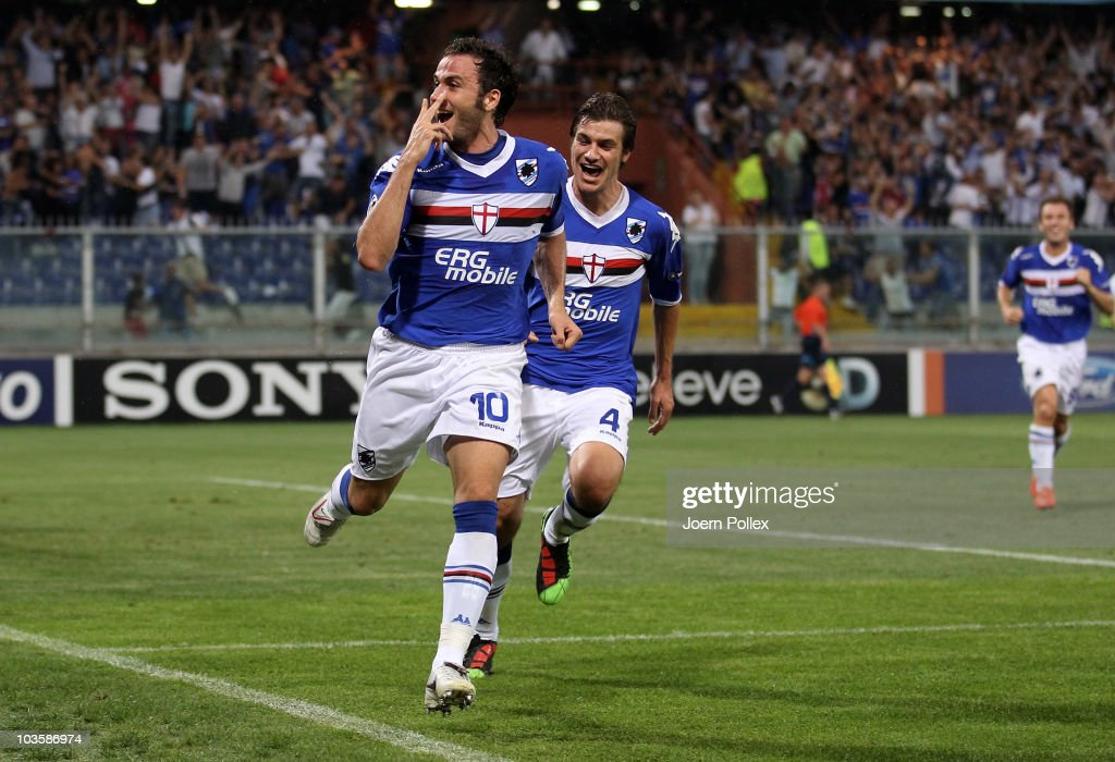 <a gi-track='captionPersonalityLinkClicked' href=/galleries/search?phrase=Giampaolo+Pazzini&family=editorial&specificpeople=800179 ng-click='$event.stopPropagation()'>Giampaolo Pazzini</a> of Genua celebrates with his team mate <a gi-track='captionPersonalityLinkClicked' href=/galleries/search?phrase=Daniele+Dessena&family=editorial&specificpeople=728068 ng-click='$event.stopPropagation()'>Daniele Dessena</a> after scoring his second goal during the Uefa Champions League qualifying second leg match between Sampdoria Genua and Werder Bremen at Stadio Luigi Ferraris on August 24, 2010 in Genoa, Italy.
