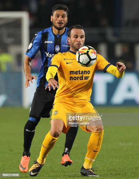 Giampaolo Pazzini of Hellas Verona FC competes for the ball with Jose Luis Palomino of Atalanta BC during the Serie A match between Atalanta BC and...