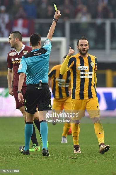 Giampaolo Pazzini of Hellas Verona FC receives the yellow card from referee Maurizio Mariani during the Serie A match between Torino FC and Hellas...
