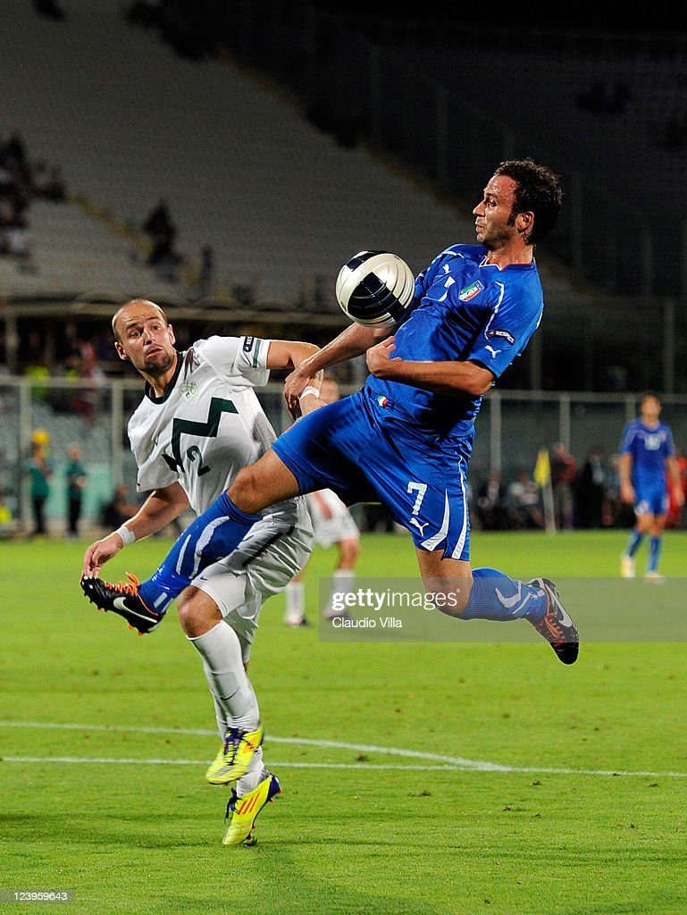 Giampaolo Pazzini of Italy and Miso Brecko of Slovenia battle for the ball during the EURO 2012 Qualifier match between Italy and Slovenia at Stadio Artemio Franchi on September 6, 2011 in Florence, Italy.