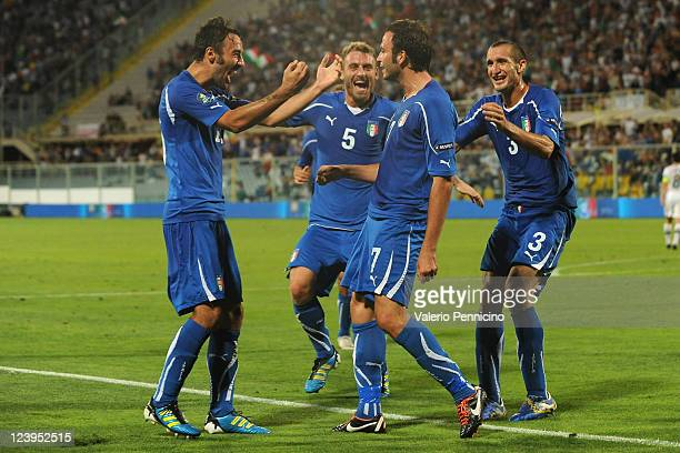 Giampaolo Pazzini of Italy celebrates with his teammates after scoring during the UEFA EURO 2012 Group C qualifying match between Italy and Slovenia...