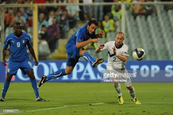 Giampaolo Pazzini of Italy scores a opening goal during the UEFA EURO 2012 Group C qualifying match between Italy and Slovenia at Stadio Artemio...