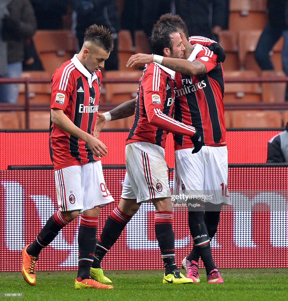 Giampaolo Pazzini (C) of Milan celebrates with team-mates after scoring the opening goal during the Serie A match between AC Milan and Bologna FC at San Siro Stadium on January 20, 2013 in Milan, Italy.