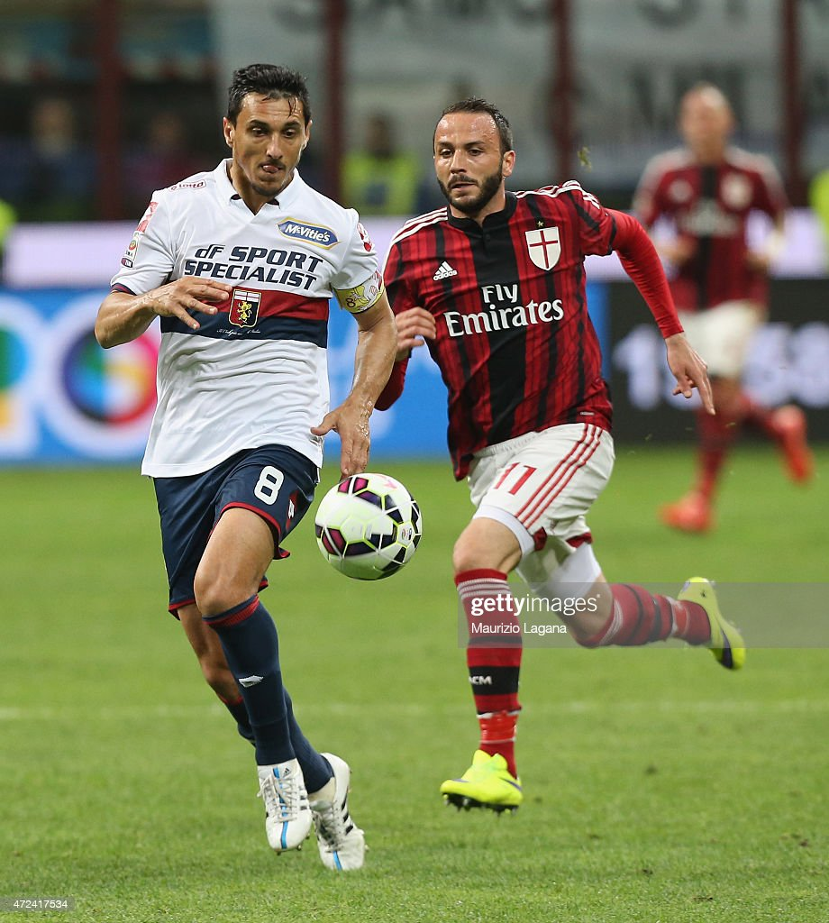 Giampaolo Pazzini of Milan competes for the ball with Nicolas Burdisso of Genoa during the Serie A match between AC Milan and Genoa CFC at Stadio...